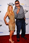 Paris Hilton and Afrojack arrive at the TRANS4M i.a.m.angel pre-Grammy party at Hollywood Palladium on Thursday, February 9